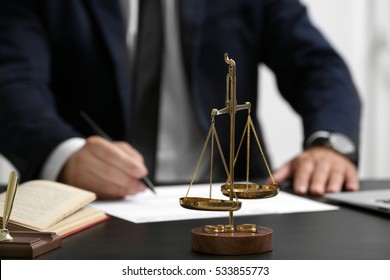 Scales of justice on table, closeup