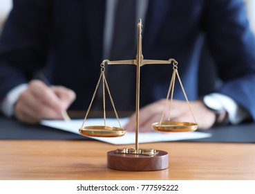 Scales of justice on table in notary's office