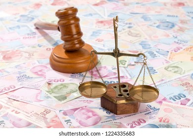 Scales of justice over Turkish Lira background.
