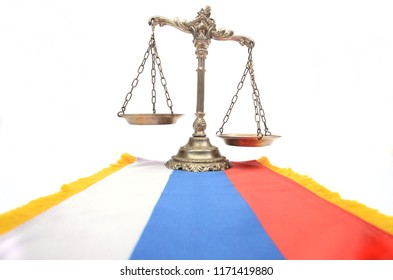 Scales of Justice and Russian Federation flag on the white background, concept of law in Russian Federation