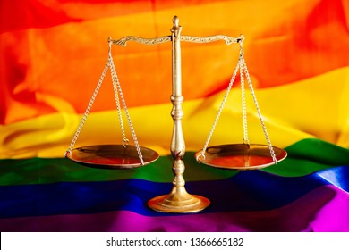Scales of justice symbol of law and justice with lgbt flag in rainbow colours. Lgbt rights and law