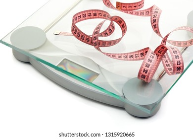 Scales and measuring tape on a white background. Top view. Healthy lifestyle concept. Slimming, diet, and control of weight.
