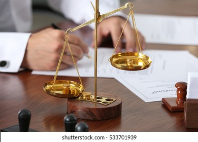Scales on notary public table, concept