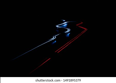 scalextric car around track in the dark
