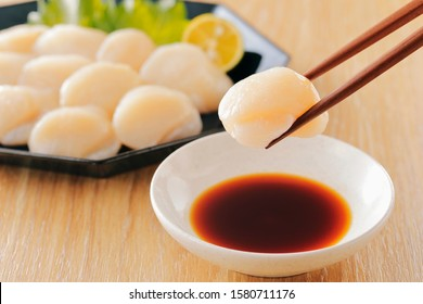 Scallop sashimi on wooden board. Japan cuisine.