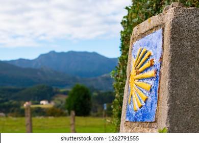 Scallop shell - touristic symbol of the Camino de Santiago showing direction on Camino Norte in Spain.