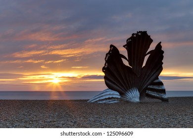 The scallop at sunrise on Aldeburgh beach. The sculpture was created by artist Maggi Hambling and dedicated to Benjamin Britten.