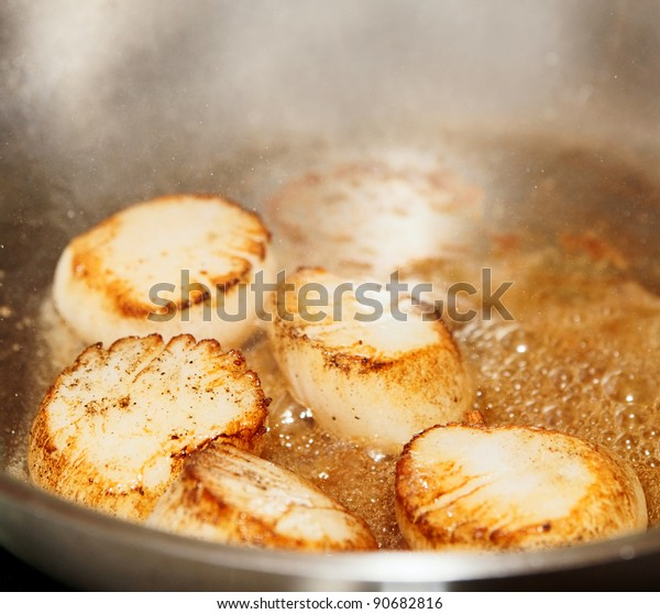 Scallops on hot  steel pan, close-up shot