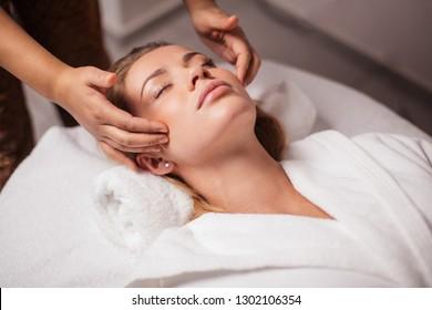 scalp massage. anti-stress facial massage. girl resting in a luxury spa resort