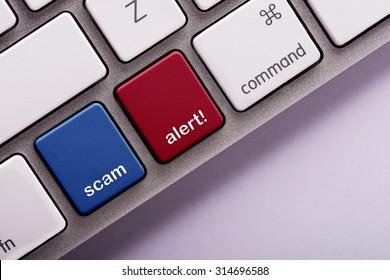 Scam Alert button on white computer keyboard
