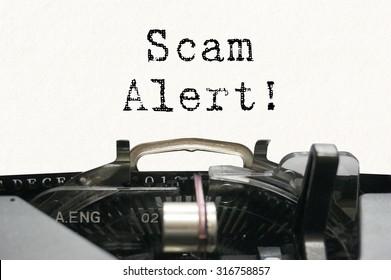 Scam alert on typewriter
