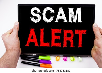 Scam Alert text written on tablet, computer in the office with marker, pen, stationery. Business concept for Scam Alert white background with space