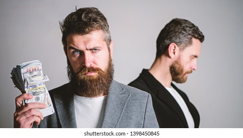 Scam and deception. Man bearded fraudster hold cash money while victim stand sad background. While no one watching. How recognize scam and protect yourself. Dishonest scheme. Scam and fraud concept.