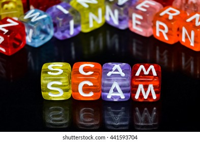 SCAM spell on colorful dice or bead. Selective focus and shallow DOF.