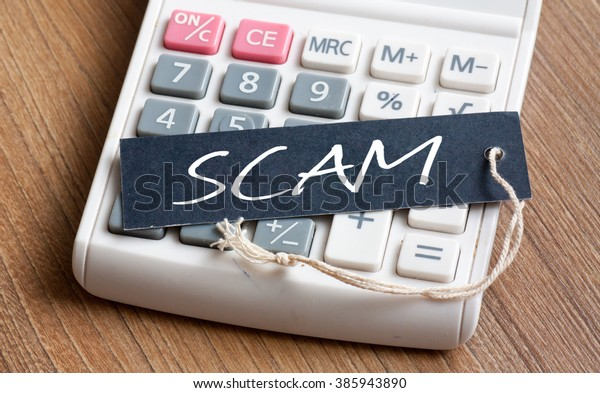 SCAM word written on label with calculator,Business Concept