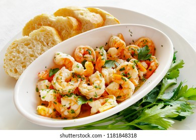 scampi fried in garlic butter and olive oil with parsley and bread