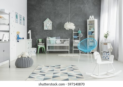 Scandi style, spacious child room with cot, bookshelf and dresser