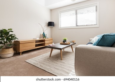 Scandi styled living room with low buffet and indoor plant