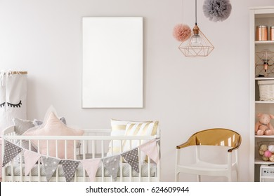 Scandinavian baby room with white crib, chair, bookshelf, wall poster