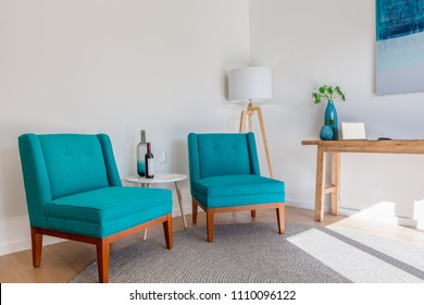 Scandinavian furniture interior with copy space - armchairs, small tables and lamp under natural sunlight