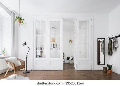 Scandinavian home interior with amazing old glass door in white