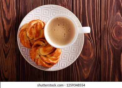 Scandinavian homemade cinnamon buns and cup of coffee