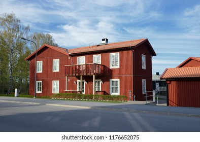 Scandinavian housing, classic red villa with blue sky
