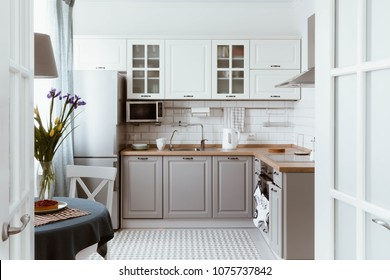 Scandinavian interior design. White grey kitchen room organization