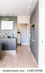 Scandinavian interior design. White grey yellow green color kitchen room organization