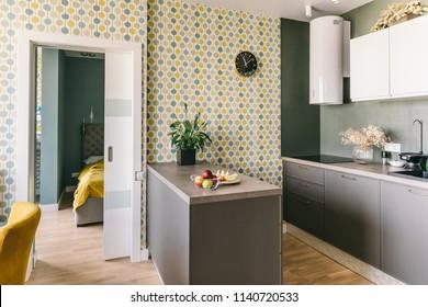 Scandinavian interior design. White grey yellow green color kitchen room organization