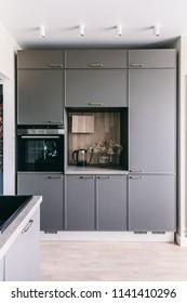 Scandinavian interior design. White grey wooden kitchen room organization