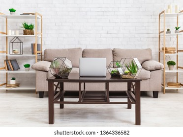 Scandinavian interior. Room with wooden table and glass florariums