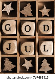Scandinavian Merry Christmas with wooden dices and the words God Jul