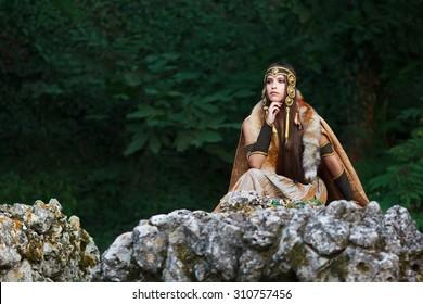 Scandinavian rich girl in deep forest.Medieval story