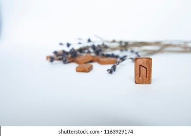 Scandinavian runes. Wooden runes on a table on a white background.