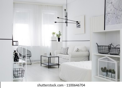 Scandinavian style living room interior with windows, black lamp, white couch and poster on the wall