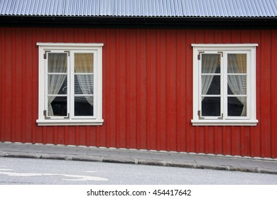 Scandinavian style red house on the street in Iceland.