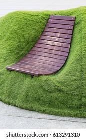 Scandinavian style wooden seat in the garden.