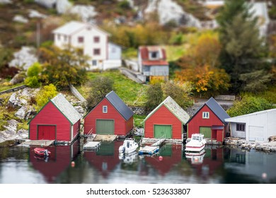 Scandinavian village in miniature. Panorama of the town. Small houses, boats. Coast Sea. Tilt shift effect. Europe.