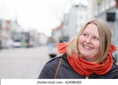 Scandinavian woman looking at copyspace in town - Horsens,Denmark