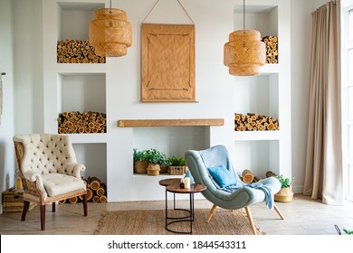 Scandinavian-style interior with a decorative fireplace and niches in the wall where wood is stored. bright, simple and cozy home design.