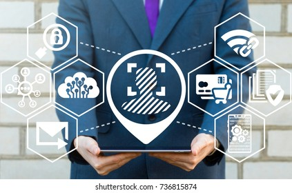 Scanning Biometric Facial Recognition Electronic Devices concept. Personal Access Privacy Identity Technology. Young businessman using tablet computer with face recognition icon on virtual interface.
