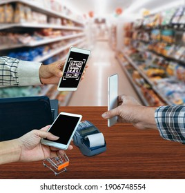 Scanning payment and verification. Businessman holding mobile smart phone  scanning  payment, buy and sell products .clipping path