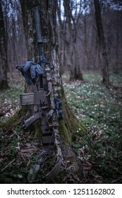 Scar Mk17 airsoft replica leaning against a tree at dusk