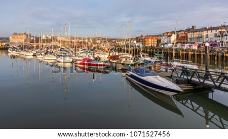 SCARBOROUGH - April 7, 2018: pleasure boats and yachts tied up in a Yorkshire harbour, UK.