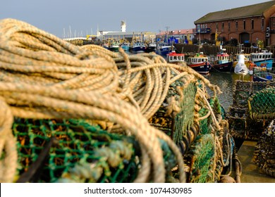 SCARBOROUGH, ENGLAND - APRIL 21: Scarborough fishing boats, and equipment in the harbour on a beautiful warm evening. In Scarborough, England. On 21st April 2018.