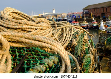 SCARBOROUGH, ENGLAND - APRIL 21: Lobster pots stacked in Scarborough fishing harbour. In Scarborough, England. On 21st April 2018.