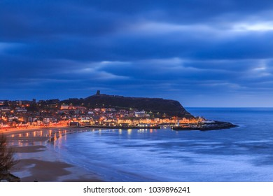 SCARBOROUGH, ENGLAND - FEBRUARY 24: Scarborough beach, town, and castle at dawn. In Scarborough, England. On 24th February 2018.