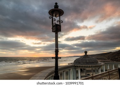 SCARBOROUGH, ENGLAND - FEBRUARY 24: Scarborough beach, spa bandstand and sea at sunrise. In Scarborough, England. On 24th February 2018.