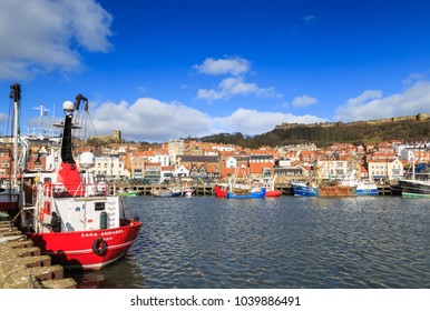 SCARBOROUGH, ENGLAND - FEBRUARY 24: Fishing boats in Scarborough harbour on a sunny Winter morning. In Scarborough, England. On 24th February 2018.